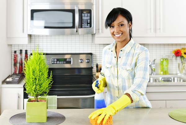 A picture of a woman cleaning.